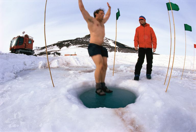 man jumping into icy water