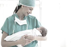 Nurse holding swaddled baby