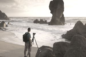 Photographer enjoying his hobby at the beach