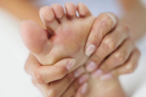 Massaging Foot for Foot Pain
