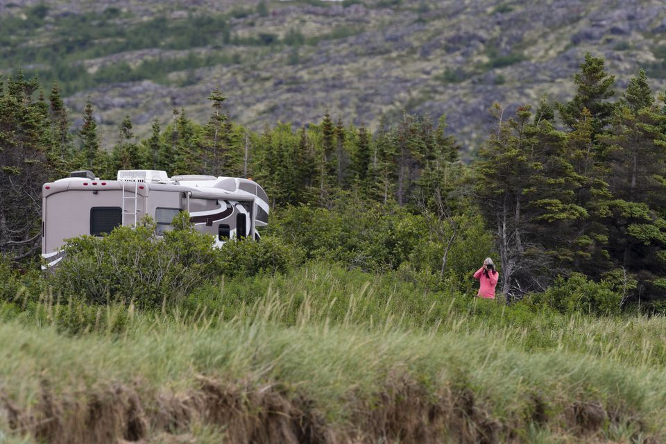 Woman photographing in road trip in Labrador and Newfoundland.