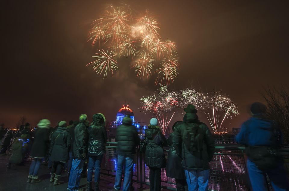 Rear view of people watching fireworks at Fire on Ice Festival, Montreal, Quebec, Canada