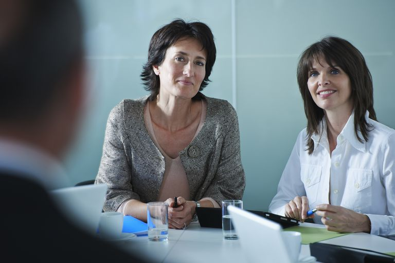 Businesswomen interviewing candidate in office