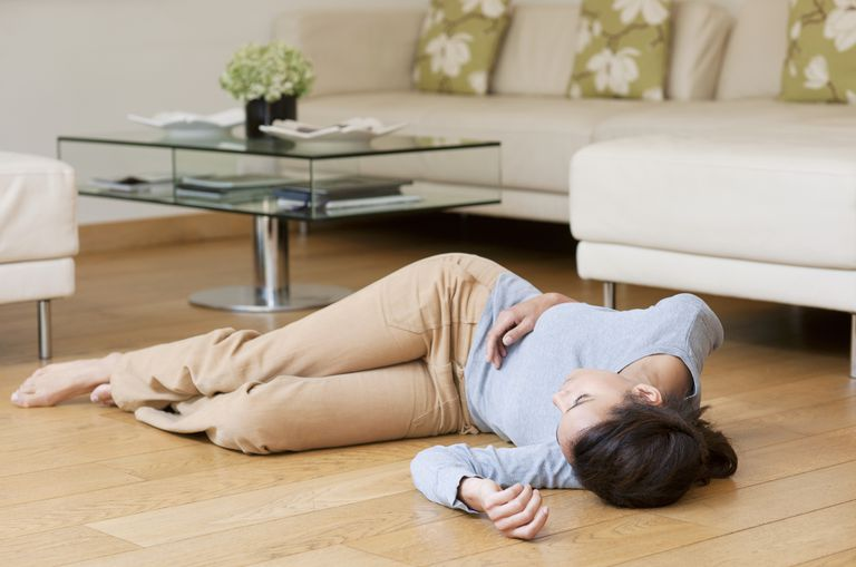 woman lying on floor after fainting