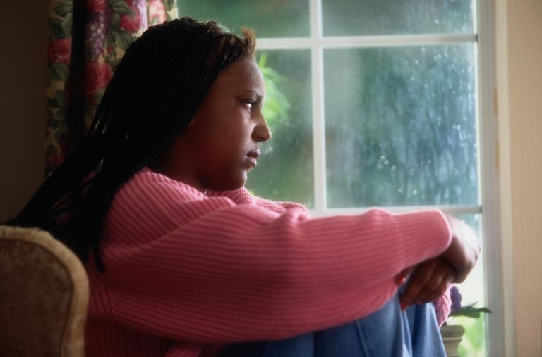 Teen Girl Looking Out a Window
