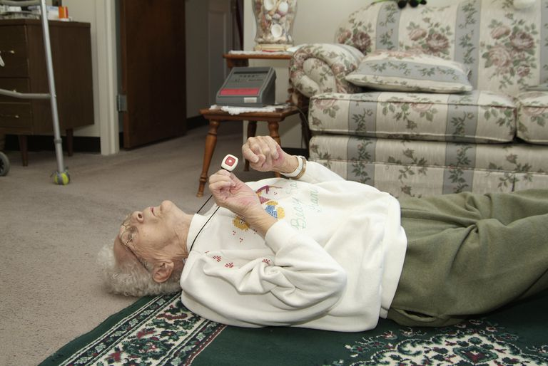 woman on floor using medical alert button