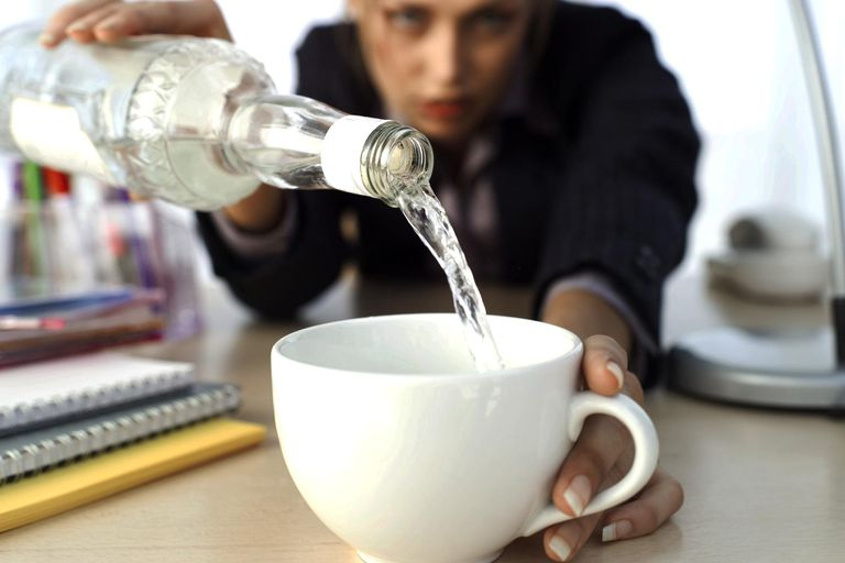 close-up of a businesswoman pouring vodka into her coffee cup : Stock Photo View similar imagesMore from this photographerDownload comp Close-up of a businesswoman pouring vodka into her coffee cup