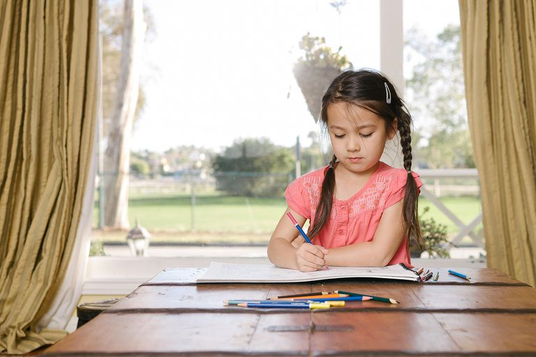 girl doing word search at table