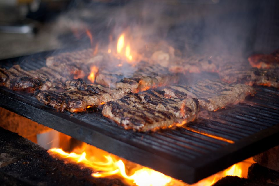 grill with stakes over an open flame