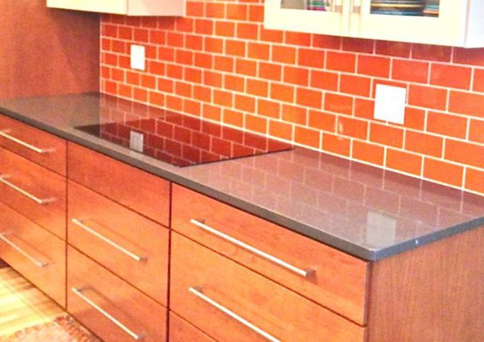 Brickwork Backsplash? No, It's Orange Glass Subway Tile.