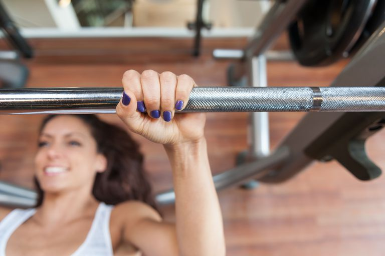 Woman weight training at the gym