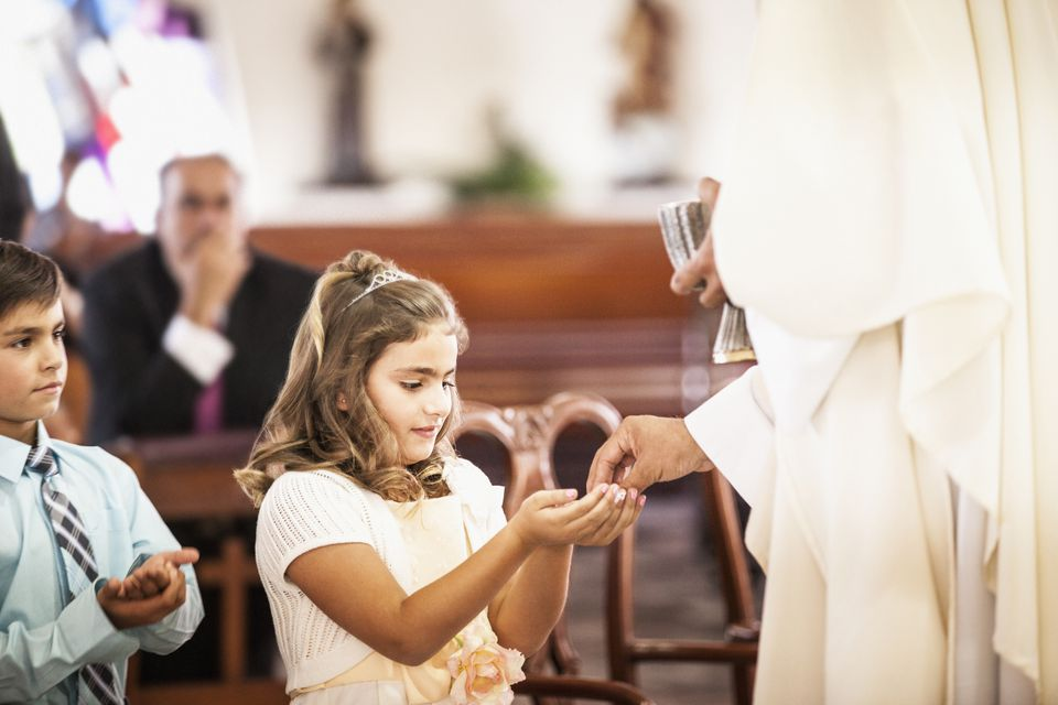 Girl taking her first communion at church