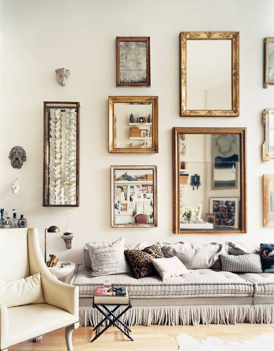 Framed mirrors in a gallery wall