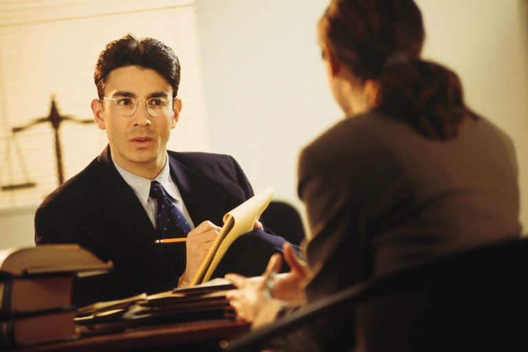 Lawyer consulting with client