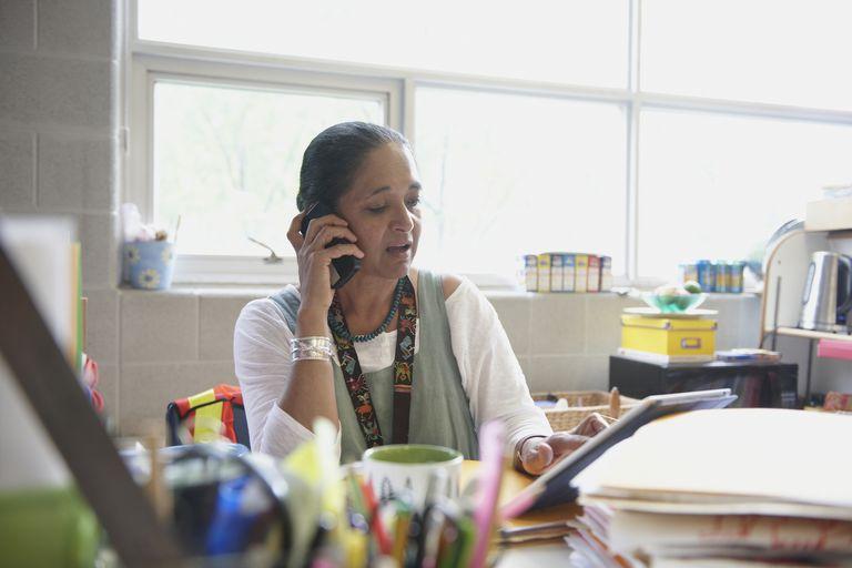 Older woman at desk using tablet