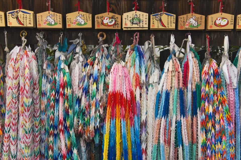 These senbazuru origami cranes with wishes are displayed in the Fushimi Inari Shrine