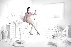 Woman in a white room with paper planes.