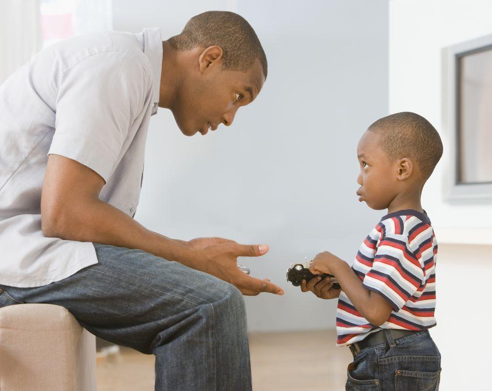 Dad disciplining his son.