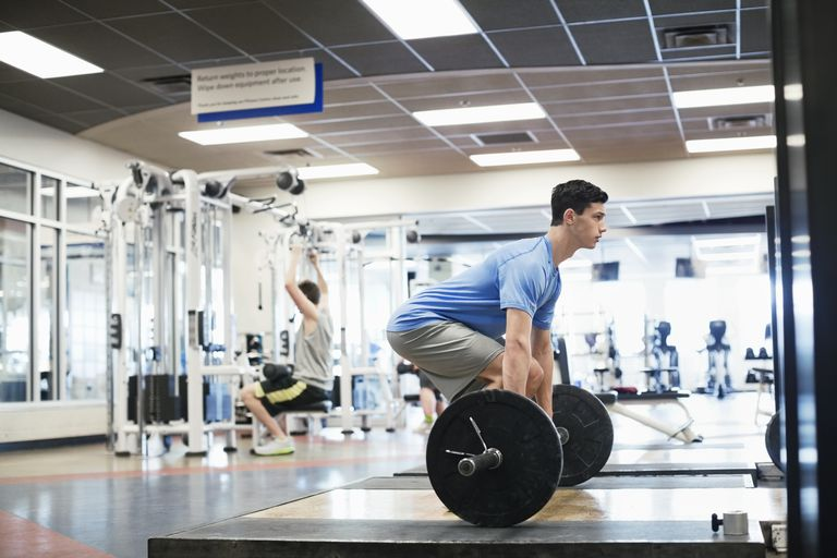 Man doing deadlifts in gym