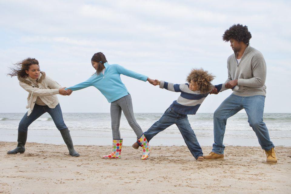 Family Fighting Over Children On Winter Beach