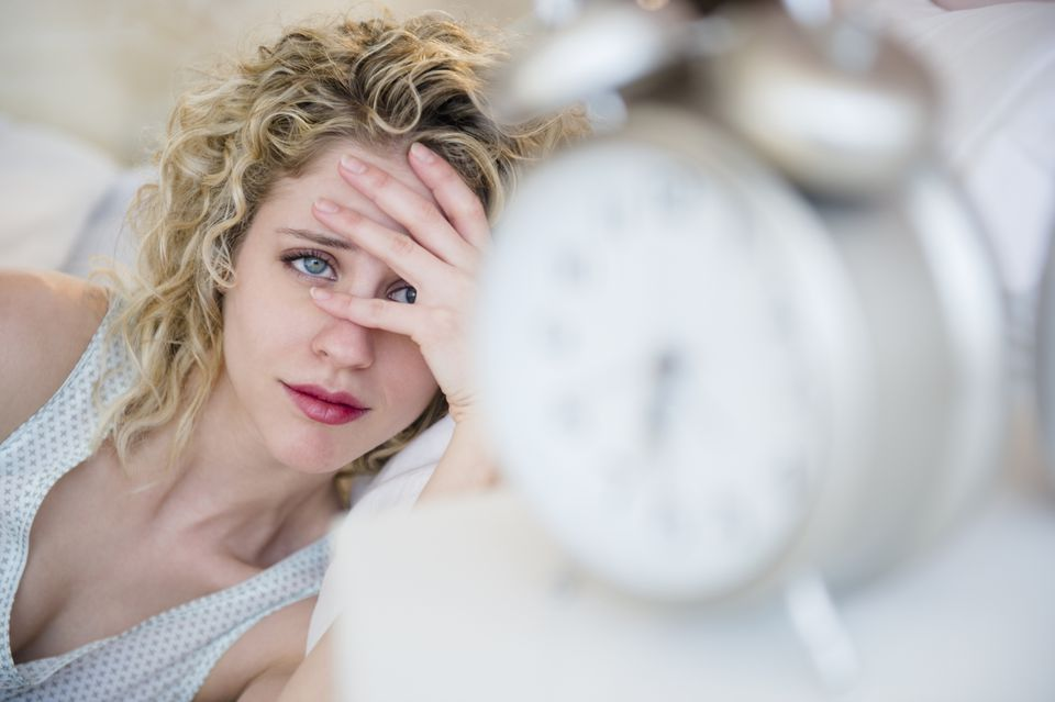 Woman dreads looking at the clock