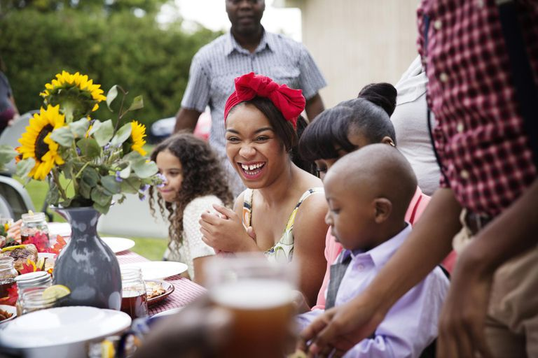 Teen Girl Laughing at Family Reunion Dinner