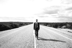 Businessman on a desert highway