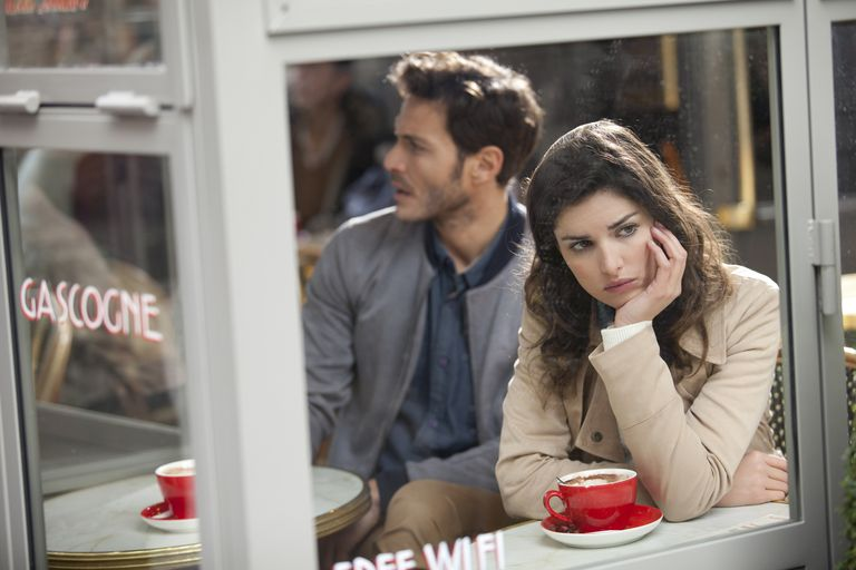 woman upset and distracted from coffee with man