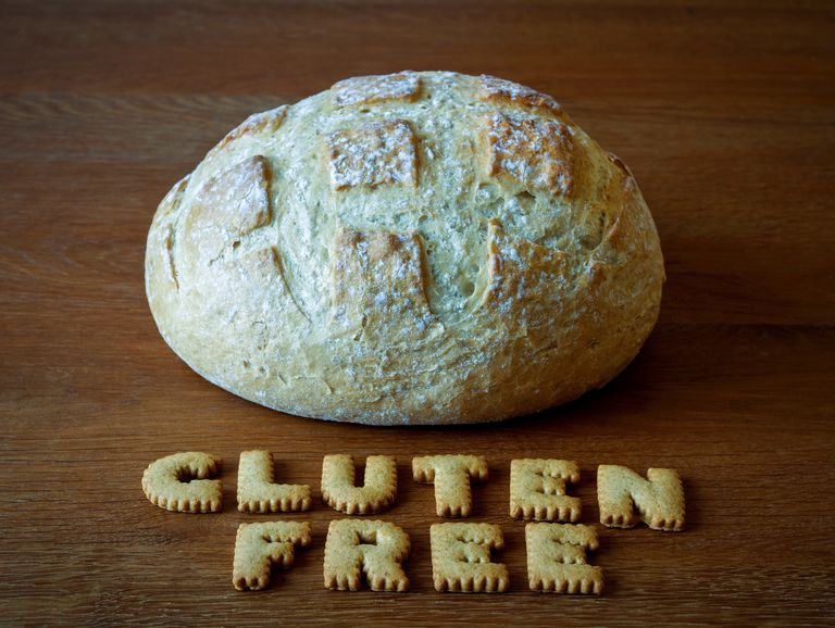 Close-Up Of Bread And Cookies In Text On Table