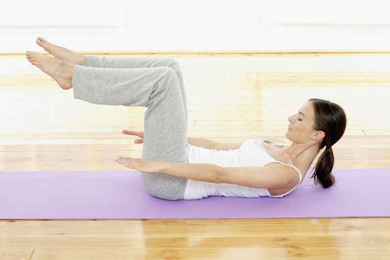 The Pilates tabletop legs position.