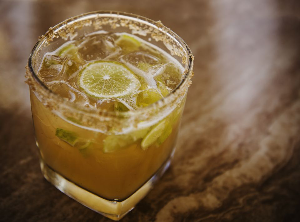 Whiskey sour cocktail on the rocks with lime
