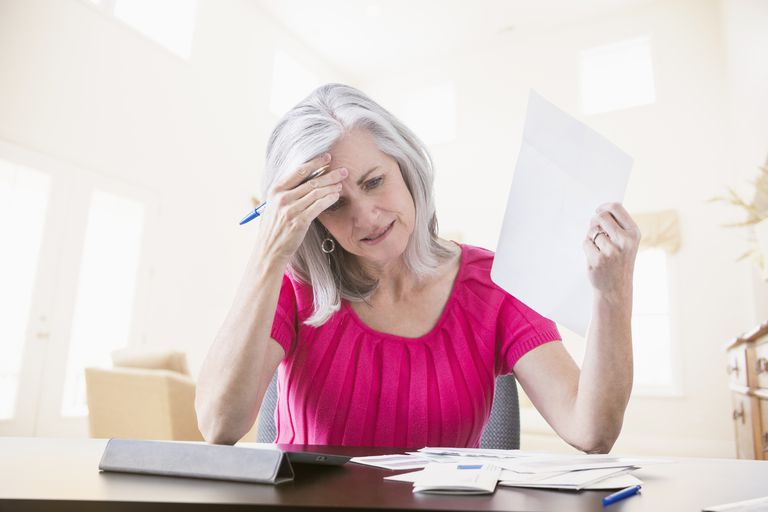 Woman is frustrated paying bills
