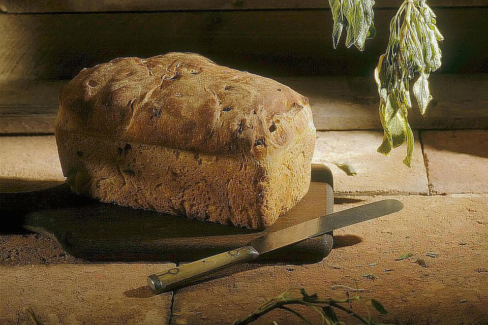 A Loaf of Bread with Fresh Sage