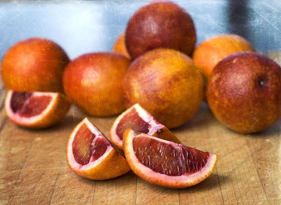 Blood oranges, whole and cut