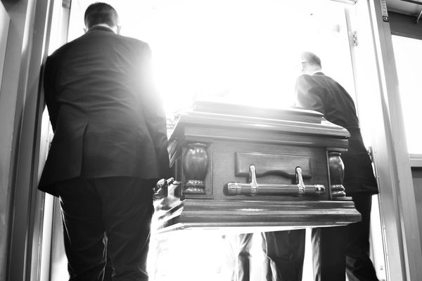 Pallbearers with casket