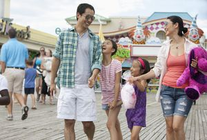 Military family enjoying amusement park