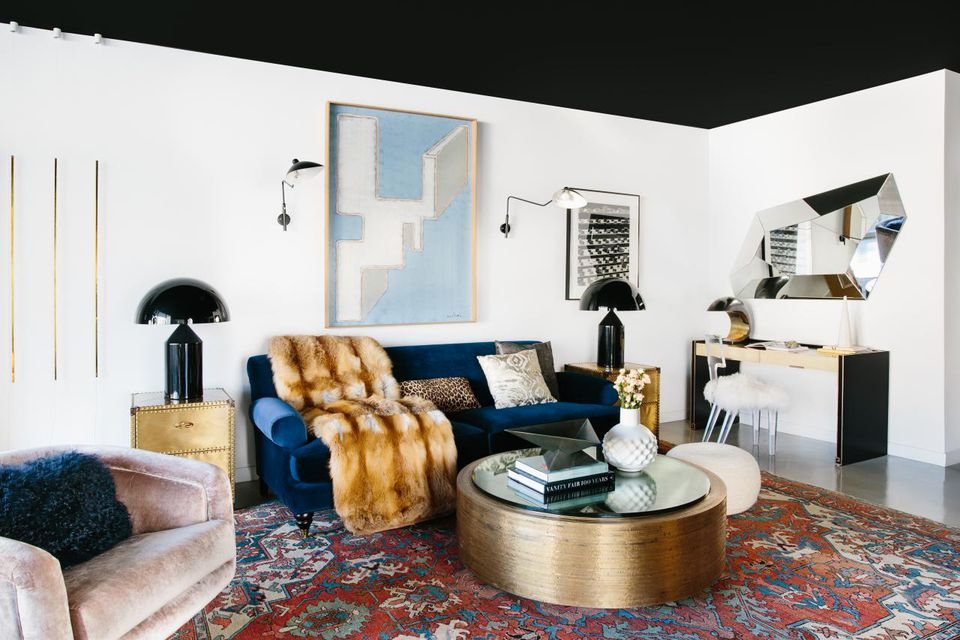 Black ceiling in chic white living room