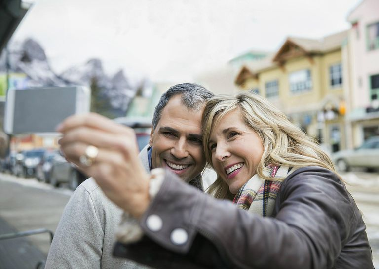 Smiling couple taking selfie outdoors