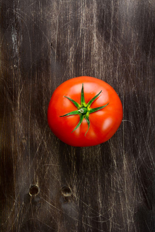 Fresh tomato on wooden background