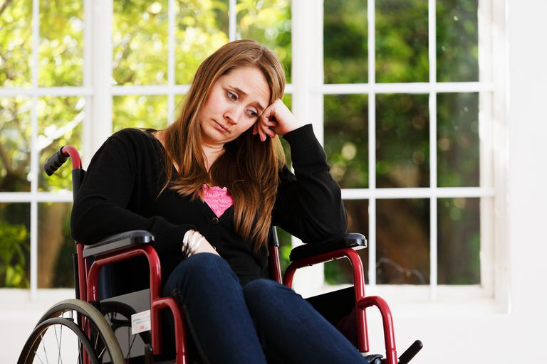 Young woman in wheelchair.