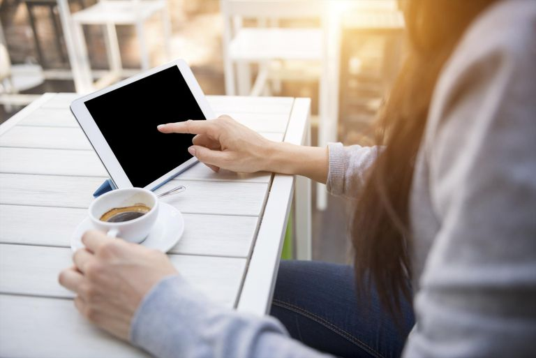Young woman with digital tablet at the cafè