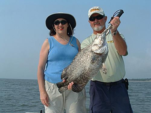 Linda caught this 15 pound tripletail while fishing with Captain Mike Evans
