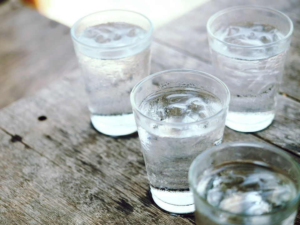 Glasses of water on picnic table