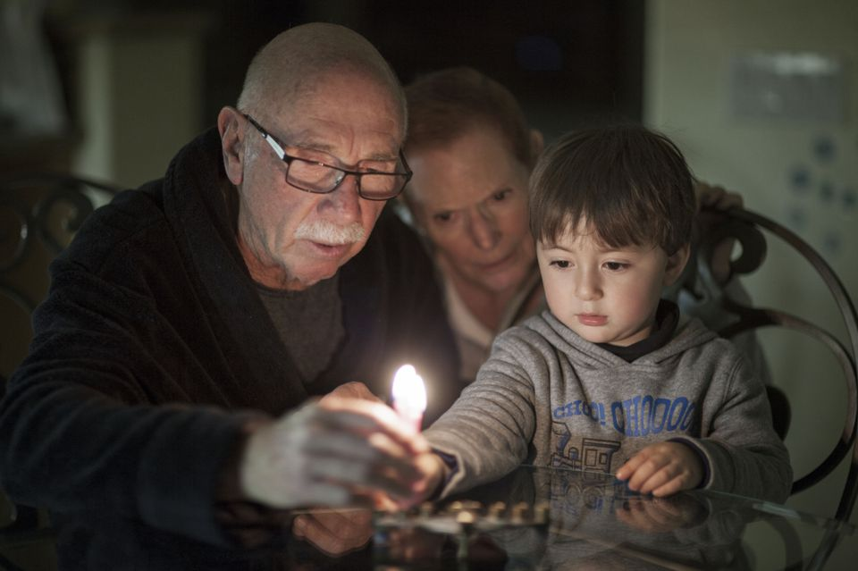 Jewish grandfather with wife and grandson