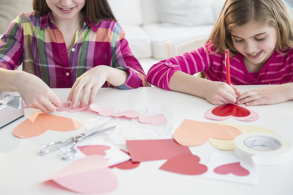 Girls making Valentine's Day cards