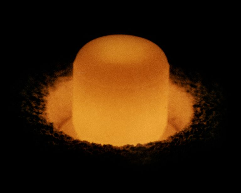 Pure plutonium is silvery, but acquires a yellowish tarnish as it oxidizes. Plutonium is pyrophoric, so it appears to glow in air as its outer surface burns.
