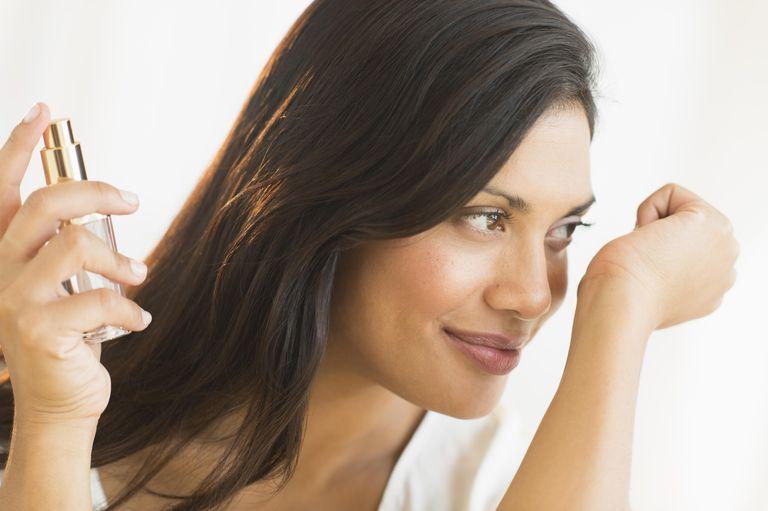 USA, New Jersey, Jersey City, Woman smelling perfume on wrist