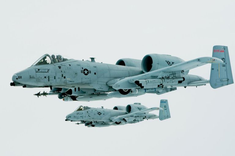 First Lt. Micha Stoddard, flying the lead aircraft, and his wingman, Capt. Casey Peasley, fly their A-10 Thunderbolt IIs in an echelon formation March 26, 2014, enroute from Barksdale Air Force Base, La., to their home base in Boise, Idaho. The crews performed an in-air refueling with a Utah National Guard KC-135 Stratotanker after the air combat exercise Green Flag East. Stoddard and Peasley are assigned to the 190th Fighter Squadron.