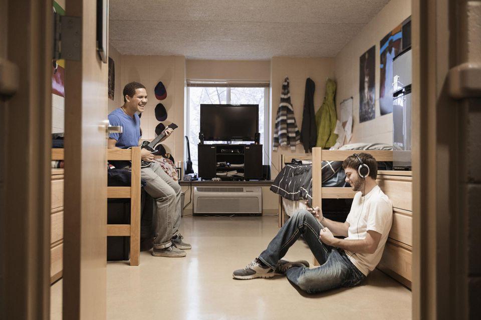 Students relaxing in dorm room.