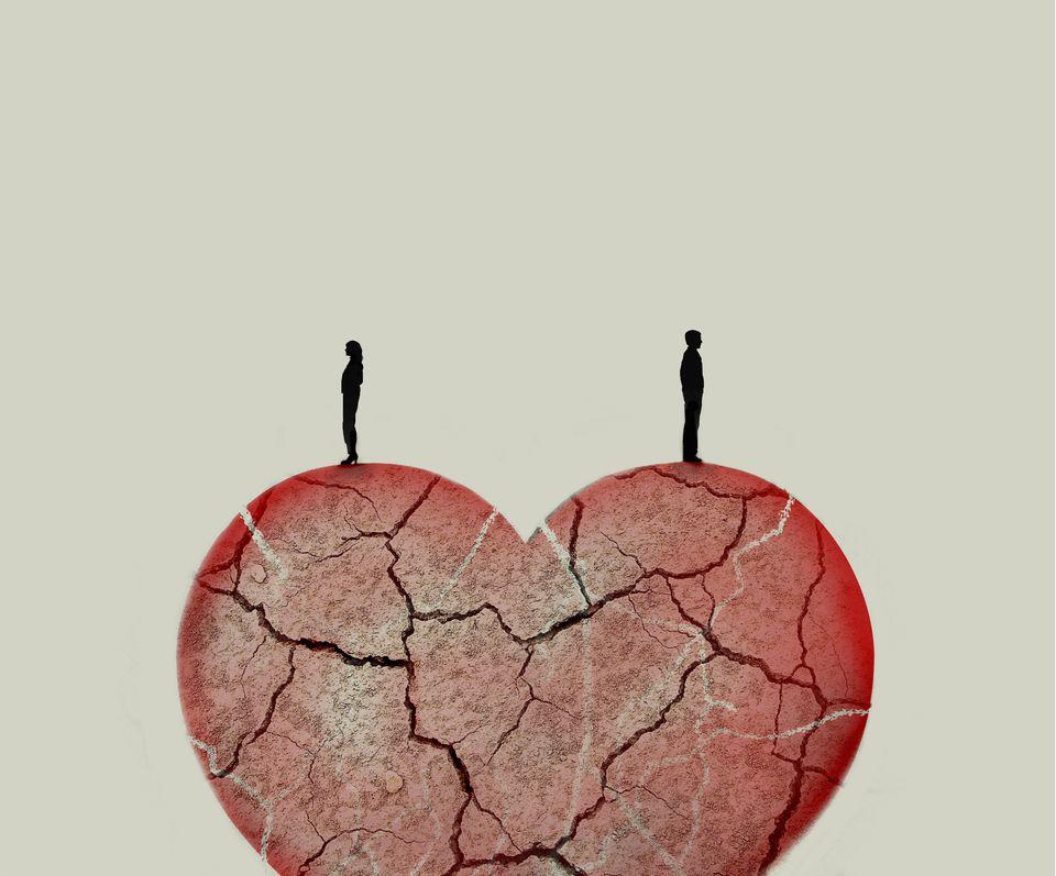 Couple standing on top of broken heart